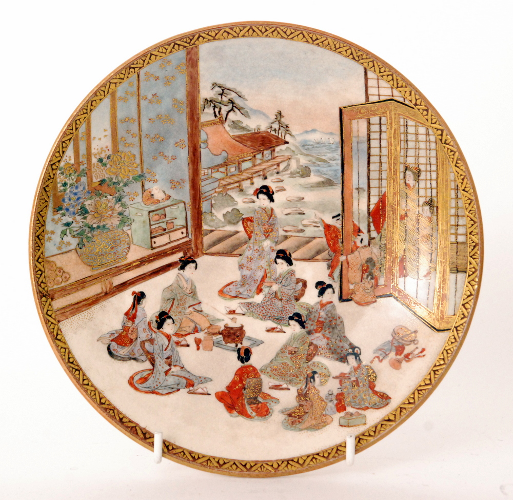 Lot 10 - A 19th Century Japanese Meiji period Satsuma plate decorated with robed ladies and children sat in