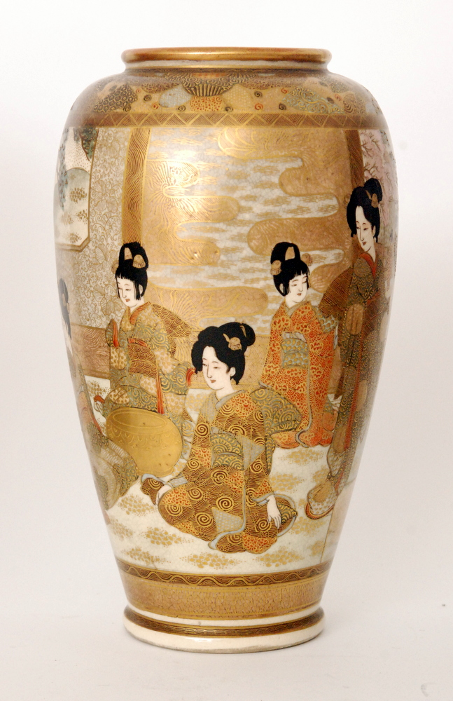 Lot 11 - A pair of late 19th Century Japanese Satsuma vases each decorated in the round with a scene of
