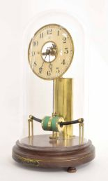 "Lot 1108 - Electric mantel clock, the 5.25"" cream dial bearing the maker's trademark logo MFB and enclosing a"