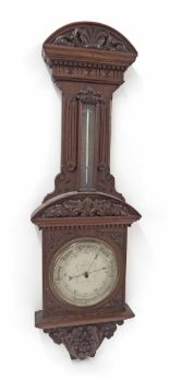 "Lot 1006 - Mahogany aneroid barometer/thermometer, the 8"" silvered dial within a foliate carved case surmounted"
