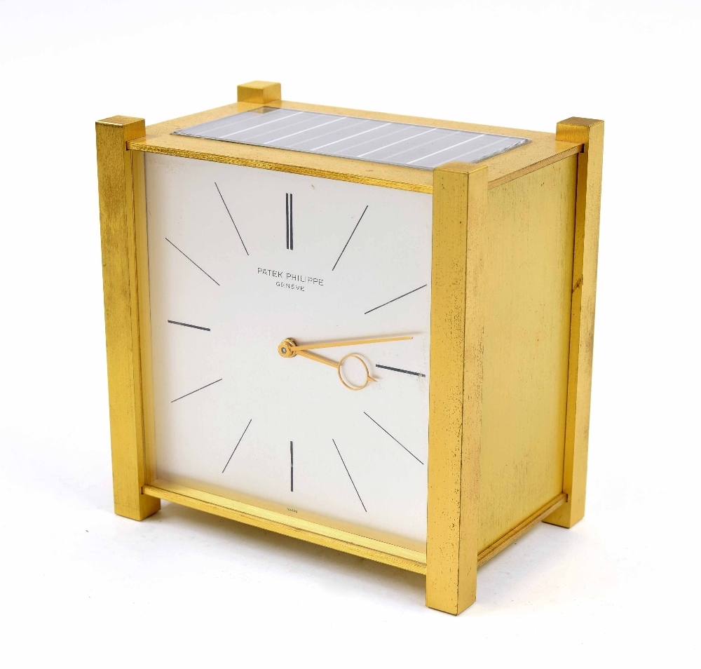 "Lot 1111 - Patek Philippe contemporary solar charge battery mantel clock timepiece, the 4.5"" square silvered di"