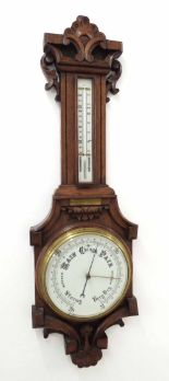 "Lot 1026 - Oak barometer/thermometer, the 8"" white dial within a good foliate carved shaped case *This"