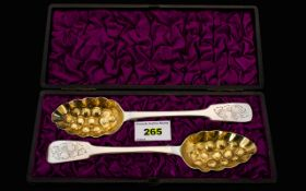 A boxed Set of 2 x Solid Silver Berry Spoons. Please see photos.