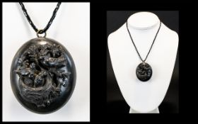 A Late 19th Century Mourning Locket Pendant Large oval ebonised wood pendant with applied bird and