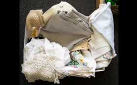 A Collection of Assorted Linen including lace doilies, table cloths, seat covers etc