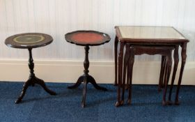 A Nest of Tables of rectangular form with carved Queen Anne Legs and apron detail,