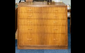 A Mid Century Teak Chest Of Drawers Designed By Peter Hayard. Comprising five long graduating