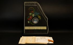 A German Jubel Tone Zither Together With Tuning Peg. Floral Decoration To Front.