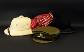 A Collection Of Hats Four in total to include Pith helmet, black bowler with inner leather band,