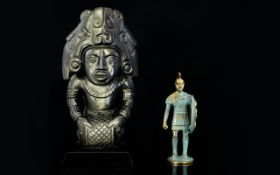 A Carved Hematite Figure In the form of a Mayan deity, 10 inches in height.