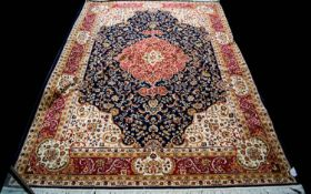 A Large Woven Silk Carpet Keshan carpet on blue ground with navy, red,