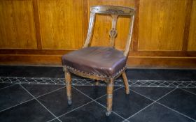 A 19th Century Carved Wood Dining Chair Carved headrest, upholstered in padded leather,