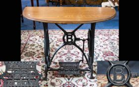 Converted Sewing Machine Console Table of typical form, demi lune top with cast iron base.