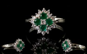 Ladies 18ct White Gold Attractive Emerald and Diamond Cluster Ring, Flower head Design. Marked 18ct.