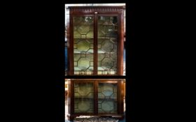 A 19th Century Sectional Mahogany Bookcase With astral glazed front,