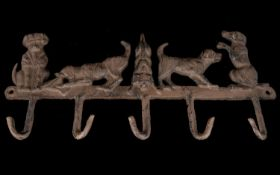 A Cast Iron 5 x Hook Key Rack, Modelled As 5 x Dogs In Different Poses. 14 Inches Long, 6.5 Inches