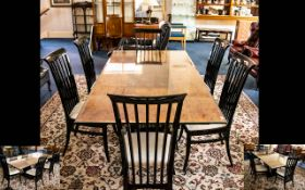 A Contemporary Maple Veneer Dining Suite By Paul Michael American designed table and accompanying