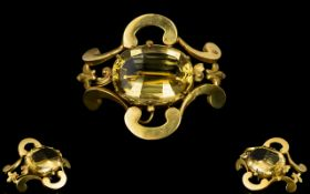 A Fine Late Victorian Brooch Set With A Large And Superb Oval Faceted Citrine The whole,