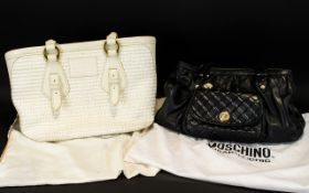 Two Designer Handbags, one Black Moschino, one cream The Bridge and both with original dust bags.