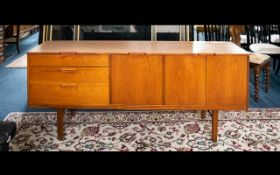 A Mid Century Teak Sideboard Of typical form with central hinged cupboard,