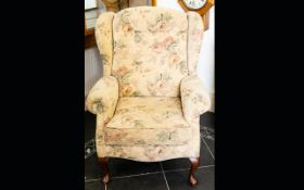 A Modern Wing Back Arm Chair Generously proportioned chair with queen anne legs, the whole