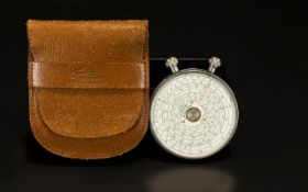 Fowlers - Circular Chrome Long Scale Calculator with Its Original Leather Case. c.1930's.
