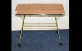 A Retro Occasional Table. Of rectangular form with grained wood finish formica top and yellow