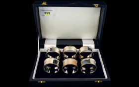 Elizabeth II Boxed Set of Six Contemporary Designed Silver Napkin Holders.
