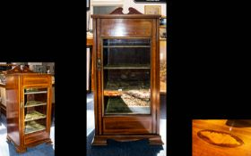 An Edwardian Display Cabinet. Raised on square feet, the whole with ribbon inlay, oval parquetry