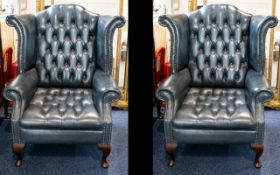 A Pair of Antique Chesterfield Club Armchairs.