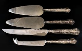 Elizabeth II Pair of Embossed Silver Handle Cake Slicers + a Matching Silver Handle Bread Knife and