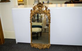 A Reproduction Rocco Style Mirror Rectangular mirror with shell and acanthus motif to top and