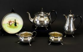 Four Piece Silver Plated Tea Set 'Yeoman' Plate. Of Plain Form With Paw Feet.