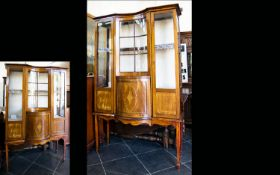 An Edwardian Bow Fronted Display Vitrine Impressive Display Cabinet with central convex cupboard and