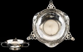 Arts And Crafts Silver Footed Bowl Planished form with three pierced handles.