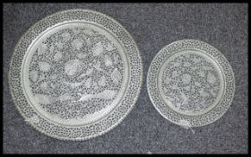 Two Middle Eastern Reticulated White Metal Charges. Largest 23x23 Inches.