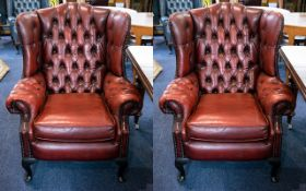 A Pair of Chesterfield Single Armchairs Of typical form with high button back,
