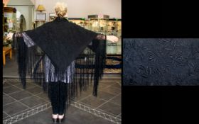 Antique Chinese Canton Black Silk Embroidered Piano Shawl Features an overall repeat fancy floral