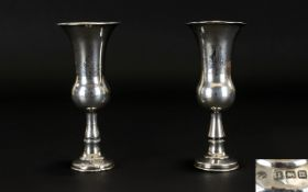 Judicea Interest A Pair Of Kiddish Cups Worn, engraved decoration to plain body,