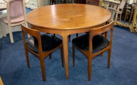 A 1960's/ 70's Teak Dining Table Extending Circular table with four accompanying chairs of typical