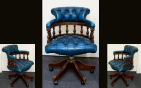 Captains Chair Raised on quatrefoil base with button seat and headrest.