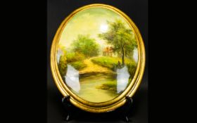 A Painted Plaster Plaque oval form conve