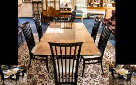 A Contemporary Maple Veneer Dining Suite