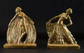 A Pair Of Art Deco Style Brass Bookends