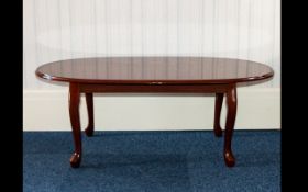 Mahogany Coffee Table Quarter veneered low table of oval form with cabriole legs.