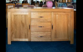 A Contemporary Oak Sideboard Of large proportions, in very good, as new condition,
