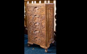 An Indonesian Carved Chest Of Drawers five drawer unit with oriental carving, height 32 inches,