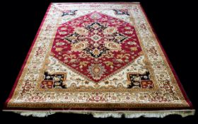 A Very Large Woven Silk Carpet Ornately patterned Heriz rug with pale gold ground and traditional
