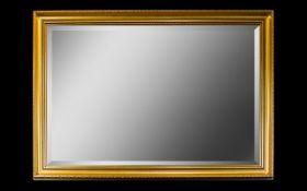 A Modern Gilt Framed Mirror Rectangular mirror in swept gilt resin frame,