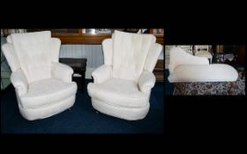 A Pair Of Armchairs Two wing back arm chairs with queen anne legs,